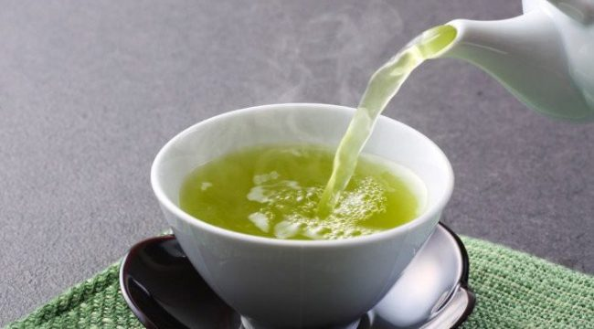 Why should you rather take green tea in-between meals?